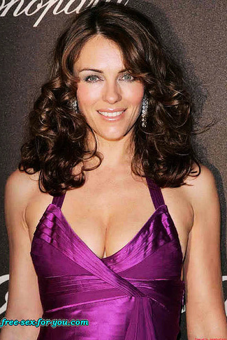 Elizabeth Hurley Hot Legs And Big Cleavage