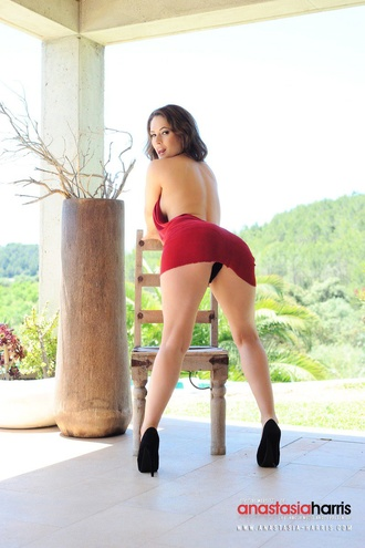 Anastasia Harris Showing Off Her Ass As She Strips From Her Red Dress