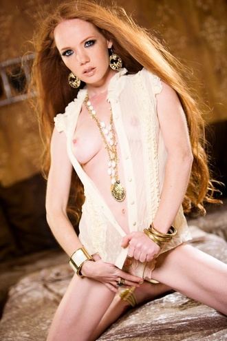 Sexy Redhead Stripping