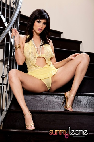 Sunny Leone Wearing A Yellow Skirt Bending Over With Her Face Down And Ass Up On Her Stairway To Heaven