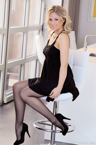 Gorgeous Nikki F Looks Glamorous In Her Little Black Dress And Heels.