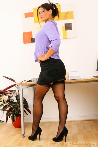 Busty Brunette In Sexy Secretary Outfit.