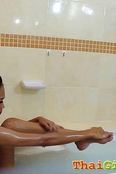 Skinny Asian Beauty Is Bathing And Fucks Her Toy