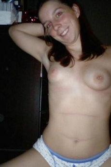 Horny Brunette Chick Shows Pierced Nipple