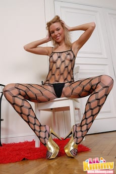 Hot Blonde Almost Naked On Her Black Net Clothes