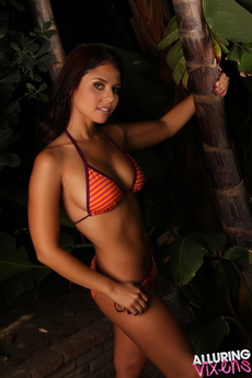 Alluring Vixen Cali Logan Shows Off In A Very Skimpy String Bikini Outdoors