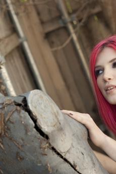 Redheaded Pierced Slut Strips Outdoors