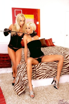 Two Beautiful Blondes With A Riding Crop Between Them... Who Wants To Play?
