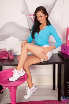 Slender Tan Hottie Slides Down Her Pink Panties Revealing Her Moist Pussy