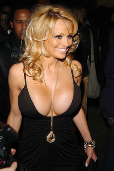 Pamela Anderson Grabs Her Big Fake Tits