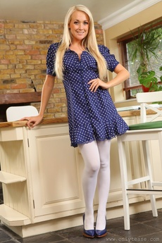 Pretty Blonde Poses Over Her Kitchen Counter