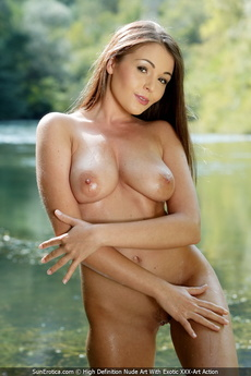 Kinky Sara Plays With Her Big Tits And Pussy At The Lush Valley In The Water