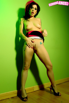 Joanna Angel Strips In Front Of A Green Wall