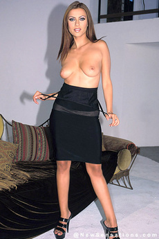 Brunette With Big Tits Strips