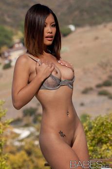 Asian Vixen Exposes Breasts