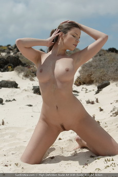 Cute Brunette With Big Tits Posing Nude On A Sandy Beach