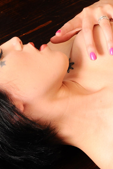 Firm Titted Brunette Strips On Table picture 13