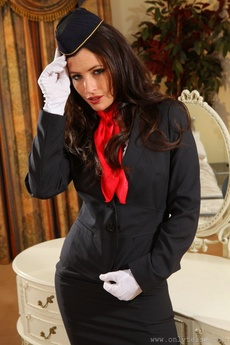 Gorgeous Dark Haired Air Hostess Teases In Her Tight Skirt Suit Before Stripping Down To Her Panties picture 1