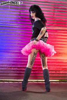 Tattooed Brunette Shows Off Panties And New Tutu picture 2